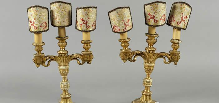 Due candelabri in legno